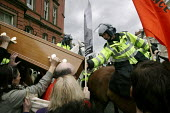 Thousands of protestors greeted Condoleezza Rice in Liverpool on her tour of NW England with Jack Straw. Here, police try to move a coffin representing war dead. - Paul Herrmann - 2000s,2006,activist,activists,adult,adults,animal,animals,anti war,anti-american,anti-US,Antiwar,anti-war,CAMPAIGN,campaigner,campaigners,CAMPAIGNING,CAMPAIGNS,casket,CLJ,coffin,DEMONSTRATING,demonstr