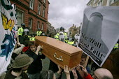 Thousands of protestors greeted Condoleezza Rice in Liverpool on her tour of NW England with Jack Straw. Here, police try to move a coffin representing war dead. Banner reads: The Wall Must Fall. - Paul Herrmann - 2000s,2006,activist,activists,adult,adults,animal,animals,anti war,anti-american,anti-US,Antiwar,anti-war,CAMPAIGN,campaigner,campaigners,CAMPAIGNING,CAMPAIGNS,casket,CLJ,coffin,DEMONSTRATING,demonstr