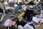 Protestors staged a mass Die-in at the Time to go anti-war march in Manchester on the eve of Labour Party Conference - Paul Herrmann - 23-09-2006