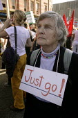 Woman with sign saying Just Go round her neck at the Time to go anti-war march in Manchester on the eve of Labour Party Conference - Paul Herrmann - 23-09-2006