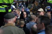 A man makes a v-sign at police during a demonstration by right wing extremists in Oldham, Lancashire, which had been banned by the Home Secretary - Paul Herrmann - 05-05-2001