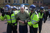 A man is led away by police during a demonstration by right wing extremists in Oldham, Lancashire, which had been banned by the Home Secretary - Paul Herrmann - 05-05-2001