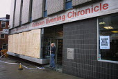 The offices of the Oldham Evening Chronicle newspaper after they had been firebombed by rioters who had accused them of biased reporting on racial issues - Paul Herrmann - 28-05-2001