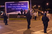 Riot police confront white youths some of whom had been attempting to reach predominantly Asian areas of Oldham, Lancashire, on the third night of disturbances around the Glodwick area. They are in fr... - Paul Herrmann - 29-05-2001