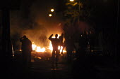 Silhouetted figures of young white rioters in front of burning barricades in Oldham, Lancashire, on the third night of race related rioting. They had been prevented from reaching predominantly Asian a... - Paul Herrmann - 29-05-2001