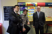 Northern Ireland Minister Dr John Reid MP (right) takes a break from the general election campaign to watch a race at a bookies in Milnrow, Lancashire, with Labour party candidate Phil Woolas (left) - Paul Herrmann - 2000s,2001,addiction,bet,Betting Shop,bookmaker,break,candidate,CANDIDATES,class,concentrate,concentrating,concentration,electioneering,flutter,gamble,gambling,intelligence,intelligent,Ireland,Irish,l