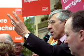 Home Secretary Jack Straw MP electioneering in Bolton, Greater Manchester - Paul Herrmann - 2000s,2001,campaign,campaigning,CAMPAIGNS,communicating,communication,DEMOCRACY,election,elections,General Election,gesture,GESTURING,Home,Labour Party,Manchester,PLACARD,placards,POL politics,politic