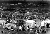 Rwandan refugees crowd into Kitale camp in the shadow of a volcano, Goma, Zaire-Congo. 1994 - Howard Davies - 03-05-1994