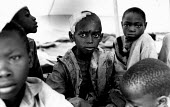 Unaccompanied rwandan refugee children in care of UNICEF, one of whom has been attacked for appearing to be a Tutsi, Goma, Zaire-Congo. 1994 - Howard Davies - 03-05-1994