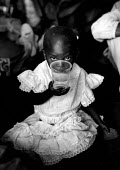 A Rwandan refugee child with clean water and ORT at MSF health centre, Bukavu, Zaire-Congo. 1994 The provision of clean drinking water prevents water borne disease. - Howard Davies - 03-05-1994