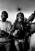Unaccompanied Rwandan refugee children singing at a Red Cross camp, Bukavu, Zaire-Congo. 1994 - Howard Davies - 03-05-1994