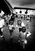 Unaccompanied Rwandan refugee children being repatriated to Kigali with UNHCR. Rwanda. 1997. - Howard Davies - 05-08-1997