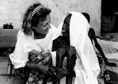 A French aid worker caring for a malnourished Somali woman at an AICF feeding centre. Bardere, Somalia. 1993 - Howard Davies - 03-05-1993