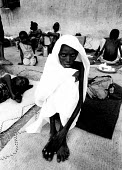 A malnourished Somali woman at an AICF feeding centre. Bardere, Somalia. 1993 - Howard Davies - 03-05-1993