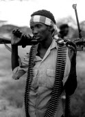 Young militia gunmen aligned to Morgans clan. southern Somalia during the famine. 1993 - Howard Davies - 03-05-1993