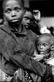Unaccompanied Rwandan refugee children in care of UNICEF and SCF having survived a massacre by rebels in Zaire-Congo. 1997 - Howard Davies - 03-05-1994