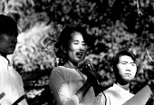 Aung San Suu Kyi addressing an NLD opposition rally outside her home. Rangoon, Burma. 1996 - Howard Davies - 05-05-1996