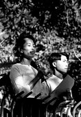 Aung San Suu Kyi addressing an NLD opposition rally outside her home. Rangoon, Burma. 1996 - Howard Davies - 1990s,1995,activist,activists,asia,asian,asians,aung,burma,burmese,CAMPAIGNING,CAMPAIGNS,conflict,conflicts,DEMONSTRATION,demonstrations,developing,FEMALE,kyi,myanmar,outside,PEOPLE,person,persons,pol
