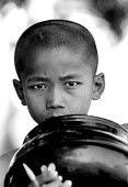 Buddhist boy monk at one of the tourist centres which prop up the military regime. Pagan, Burma. 1996 - Howard Davies - &,1990s,1995,armed forces,asia,asian,asians,belief,boy,boys,buddha,buddhism,buddhist,buddhists,burma,burmese,child,CHILDHOOD,children,conviction,developing,faith,GOD,holiday,holiday maker,holiday make