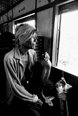 Elderly Cambodian refugee returning home on a UNHCR chartered train from camps on the Thai border. UNHCR repatriation train, Cambodia. 1992 - Howard Davies - 03-05-1992
