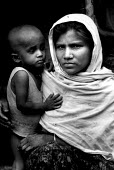 Rohingya Muslim woman and child, refugees after being removed by the Burmese military. Dumdumia refugee camp, Bangladesh - Burma border, 1992 - Howard Davies - 1990s,1992,asia,asian,asians,BAME,BAMEs,bangladesh,Bangladeshi,Bangladeshis,BME,bmes,border,border control,border controls,borders,burma,Burmese,camp,camps,CHILD,CHILDHOOD,children,conflict,conflicts,