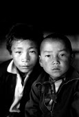 Tibetan refugee children recently arrived in Kathmandu, after escaping over the Himalayas from Chinese-occupied Tibet. Tibetan house, Kathmandu, Nepal. 1997 - Howard Davies - 03-05-1997