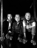 Tibetan refugee children recently arrived in Kathmandu after escaping over the Himalayas from Chinese-occupied Tibet. Tibetan house, Kathmandu, Nepal. 1997 - Howard Davies - 03-05-1997