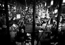 Vietnamese refugees in closed detention centre. Sham Shui Po detention centre, Hong Kong. 1988 - Howard Davies - 03-05-1988