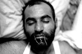 Mokhtar Haydary, aged 34, one of three Iranian Kurdish asylum seekers on hunger strike to protest against the decison by the UK government to deport them back to Iran where they believe they will be d... - Howard Davies - .,2000s,2004,activist,activists,against,asylum seeker,asylum seekers,asylum seeker,asylum seekers,BAME,BAMEs,BME,BME black,bmes,britain,CAMPAIGN,campaigner,campaigners,CAMPAIGNING,CAMPAIGNS,DEMONSTRAT
