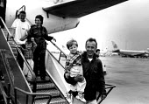 Kosovar Albanian refugees arriving on evacuation flight, Manchester airport, UK, 1999 - Howard Davies - 01-08-1999