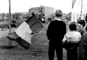 Children with republican flag, West Belfast, Northern Ireland. 1989 - Howard Davies - ,1980s,1989,activist,activists,boy,boys,britain,CAMPAIGN,campaigner,campaigners,CAMPAIGNING,CAMPAIGNS,child,CHILDHOOD,children,cities,city,conflict,conflicts,confront,confrontation,confronted,confront