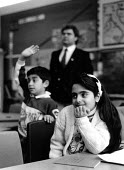Assyrian Christian refugee children learn Aramaic at mother tongue school. London, UK. 1989 - Howard Davies - 1980s,1989,adult,adults,BAME,BAMEs,Black,BME,bmes,britain,child,CHILDHOOD,children,cities,city,communicating,communication,Diaspora,displaced,diversity,edu,edu education,educate,educating,education,ed