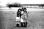 Three sisters refugees from Vietnam who have arrived in the UK on a family reunion programme, Weston super Mare, UK 1989 - Howard Davies - 01-08-1989