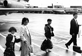 Vietnamese refugees arriving in UK from Hong Kong camps. Heathrow Airport, London, UK. 1989 - Howard Davies - 01-08-1989