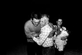 Family reunion for a Bosnian Muslim refugee with his father. The son had married and had a baby with another Bosnian refugee while living in the UK. Kljuc. Bosnia. 1996 - Howard Davies - 1990s,1996,age,ageing population,agencies,agency,aid,assistance,babies,baby,balkan,balkans,bosnia,bosnian,bosnians,charitable,charities,charity,Child,CHILDHOOD,children,Diaspora,displaced,EARLY YEARS,
