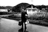 Bosnian Muslim refugee returning home with EDA having spent four years in the UK. Biljani, Bosnia. 1996 - Howard Davies - ,1990s,1996,age,ageing population,balkan,balkans,BAME,BAMEs,BME,bmes,bosnia,bosnian,bosnians,conflict,conflicts,Diaspora,displaced,diversity,Eastern Europe,elderly,EQUALITY,ethnic,Ethnic Cleansing,eth