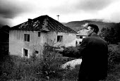 Bosnian Muslim refugee returning to find his home destroyed having spent four years in the UK. Biljani, Bosnia. 1996 - Howard Davies - ,1990s,1996,age,ageing population,balkan,balkans,BAME,BAMEs,BME,bmes,bosnia,bosnian,bosnians,conflict,conflicts,Diaspora,displaced,diversity,Eastern Europe,elderly,EQUALITY,ethnic,Ethnic Cleansing,eth
