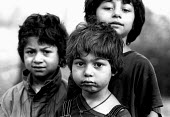Roma children in their village near Tusla, Bosnia. 1996 - Howard Davies - 1990s,1996,balkan,balkans,BAME,BAMEs,BME,bmes,bosnia,bosnian,bosnians,CHILD,CHILDHOOD,children,diversity,Eastern Europe,ethnic,ethnicity,eu,europe,european,europeans,gipsey,Gipsey Gipsy Gypsey,Gipsies