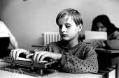 Bosnian child using a braille typewriter at a school for deaf and blind children which managed to remain open throughout the war. Tusla, Bosnia 1996 - Howard Davies - .,1990s,1996,balkan,balkans,bosnia,bosnian,bosnians,braille,CHILD,CHILDHOOD,children,disabilities,disability,disable,disabled,disablement,Eastern Europe,edu,educate,educating,education,educational,eu,