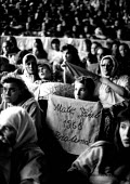 Bosnian Muslim women and children gather for the first anniversary of the massacre at Srebrenica, where more than seven thousand men were massacred by Bosnian Serb forces. Tusla, Bosnia 1996 - Howard Davies - 01-07-1996