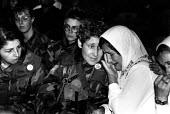 Massacre at Srebrenica, Bosnian Muslim women and children are comforted by US army women as they gather for the first anniversary of the massacre at Srebrenica, where more than seven thousand men were... - Howard Davies - 01-07-1996