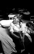 Elderly Bosnian Muslim refugee in a makeshift camp in a sports hall near Zagreb. Croatia. 1992 - Howard Davies - 01-07-1992