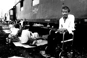 Bosnian Muslim refugee who is disabled in a makeshift camp in railway carriages. Cakovec, Croatia. 1992 - Howard Davies - .,1990s,1992,balkan,balkans,BAME,BAMEs,BME,bmes,bosnia,bosnian,bosnians,camp,camps,conflict,conflicts,croatian,Diaspora,disabilities,disability,disable,disabled,disablement,displaced,diversity,EQUALIT