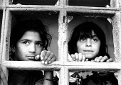 Roma children in an IDP camp where they are protected by NATO KFOR troops from reprisal attacks by Kosovar Albanians, who alleged they colloborated during the war. Obilic IDP camp, Pristina, Kosovo 19... - Howard Davies - 01-07-1999