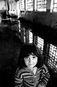 Roma children in an IDP camp where they are protected by NATO KFOR troops from reprisal attacks by Kosovar Albanians, who alleged they colloborated during the war. Obilic IDP camp, Pristina, Kosovo 19... - Howard Davies - 1990s,1999,BALKAN,balkans,BAME,BAMEs,BME,bmes,camp,camps,child,CHILDHOOD,children,conflict,displaced,displacement,diversity,EQUALITY,ethnic,Ethnic Cleansing,ethnicity,europe,female,females,gipsey,Gips