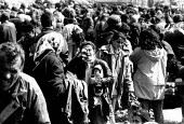 Kosovar Albanian refugees in a transit border camp at Blace having been forced from their homes by Serb forces. Macedonia - Kosovo border. 1999 - Howard Davies - 1990s,1999,Albanian,Albanians,balkan,balkans,border,border control,border controls,borders,camp,camps,child children,conflict,Diaspora,displaced,ethnic cleansing,eu,europe,european,europeans,exodus,FE
