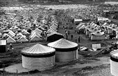 Oxfam water tanks for Kosovar Albanian refugees in Cegrane camp established by NATO having been forced from their homes by Serb forces. Macedonia . 1999 - Howard Davies - 01-07-1999