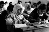 Palestinian refugee children studying at an UNRWA school, Beach refugee camp, West Bank. 1993 - Howard Davies - 01-07-1993
