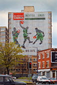 Banner advertising the local basketball team across the top 8 floors of Oldham Court, Manchester, while it is empty for refurbishment. In return the team is funding the building of a basketball court... - Paul Herrmann - 20-04-1999