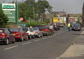 Dozens of cars queued for the last remaining petrol at Asda, Morley, Leeds, after lorry drivers and farmers blockaded fuel depots and refineries in protest at high fuel prices. - Paul Herrmann - 11-09-2000